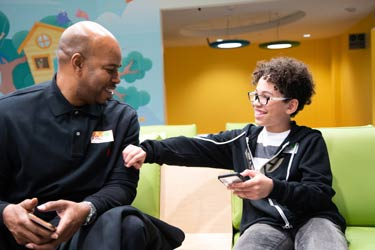 Patient and Father in Neurological Institute Outpatient Center