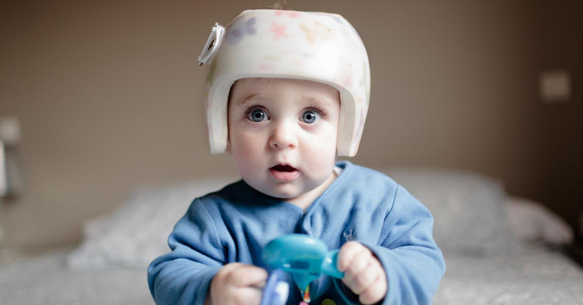 Cute baby boy wearing a helmet