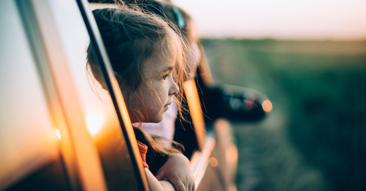 CHLA Blog - Motion Sickness - Girls looking out car window