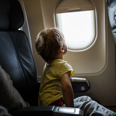 CHLA Blog - Motion Sickness - Boy looking out airplane window