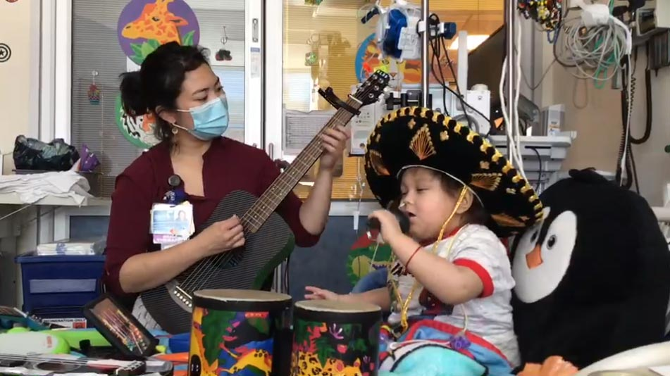 Nano and a CHLA music therapist performing a song together
