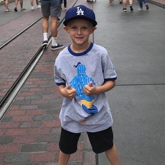 Josh at Disneyland giving two thumbs up
