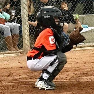 Josh playing catcher during a little league baseball game