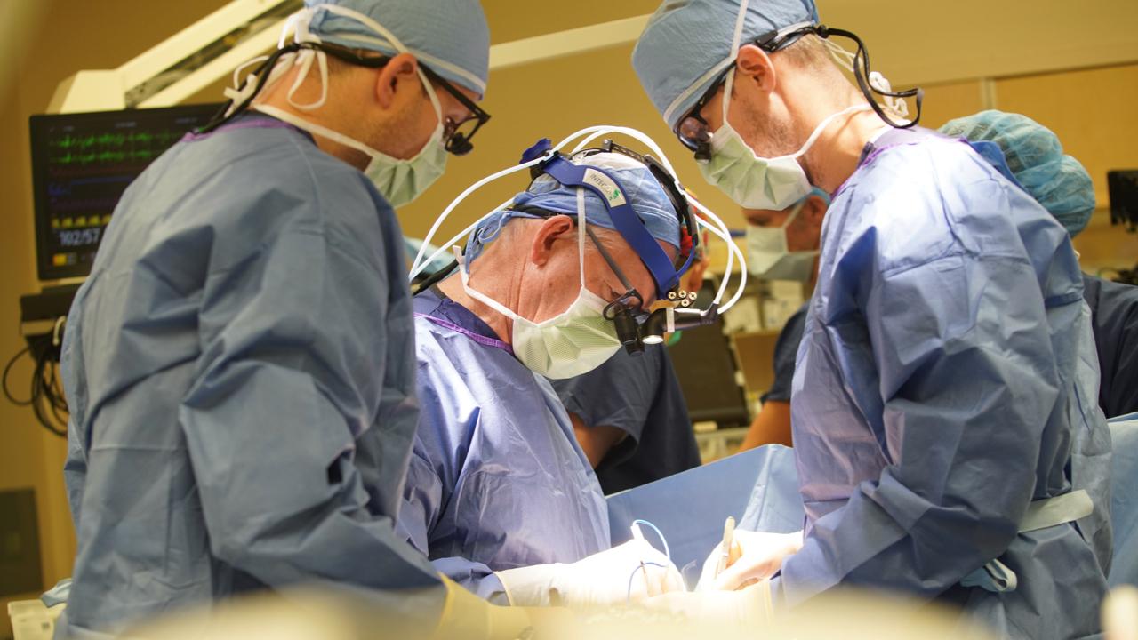 Surgeons at operating table performing surgery at CHLA