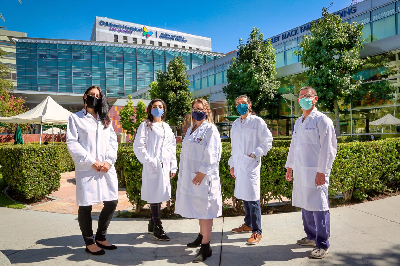 Four research team members standing outside at Children's Hospital Los Angeles