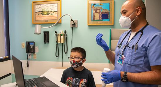 Taking forehead temperature - Coronavirus Safety at Children's Hospital Los Angeles