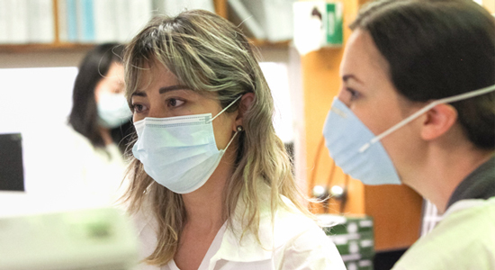Women researchers wearing masks while working - Coronavirus Safety at Children's Hospital Los Angeles
