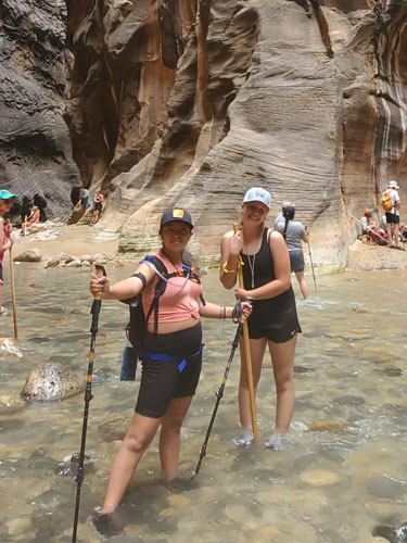 Desiree and friend hiking at Zion National Park