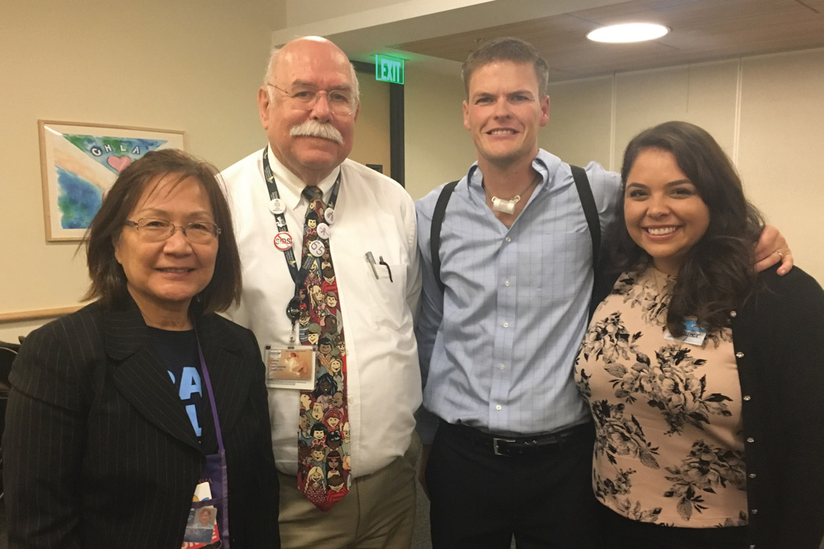 Sheila Kun, RN (left), Thomas Keens, MD, and Jim and Brittany Harrison
