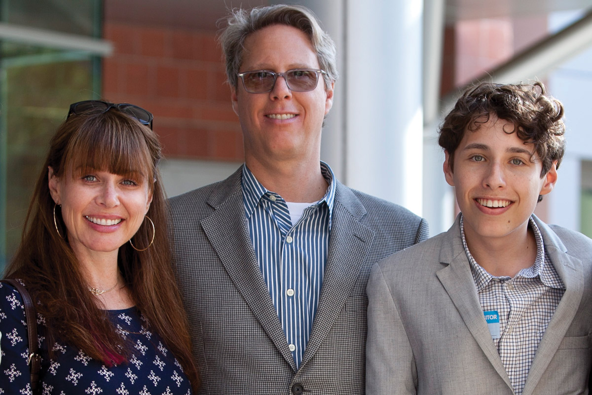Higgins Family Charitable Foundation Trustees Samantha and Harvey Moss with their son, Caleb