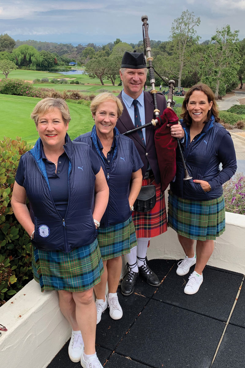 Left to right: Seahorse Classic Chairs Heather Schuchert, Hilary Waxler and Heidi Sampson with bagpiper Eric Rigler