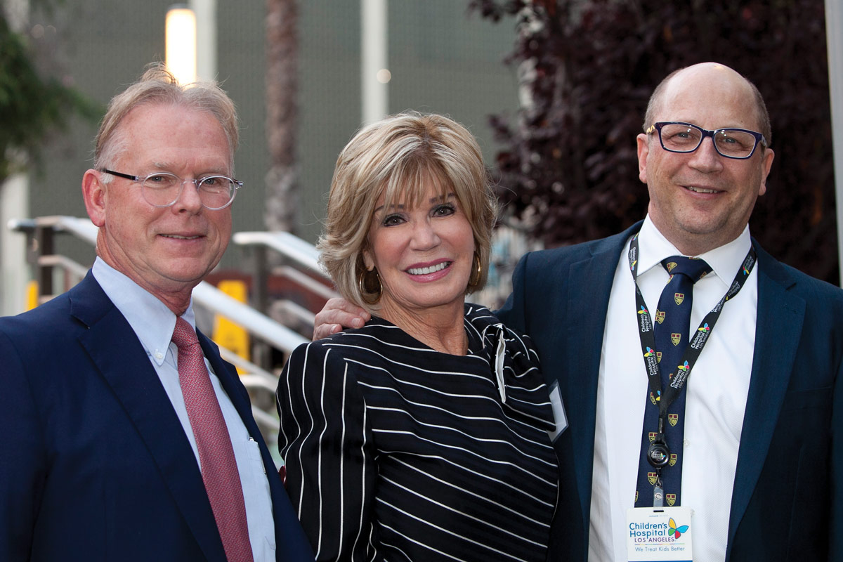 Heart Institute Co-Directors Vaughn Starnes, MD (left), and Paul Kantor, MBBCh, MSc, FRCPC (right), with Cheryl A. Dickins