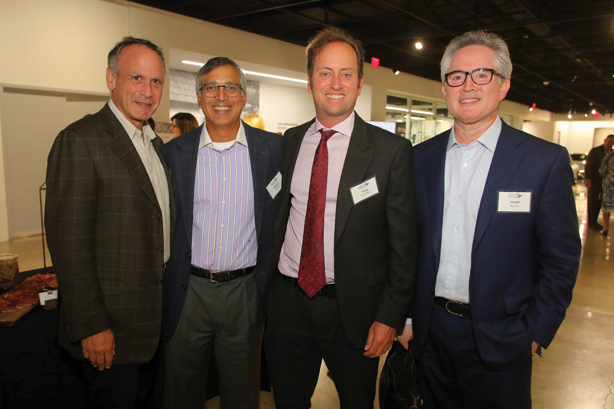 Left to right: Laurence Paul, MD, a member of the CHLA Board of Directors and Foundation Board of Trustees; Ashwin Adarkar, a CHLA Foundation Trustee; Doug Kazanjian; and Joseph Barrios