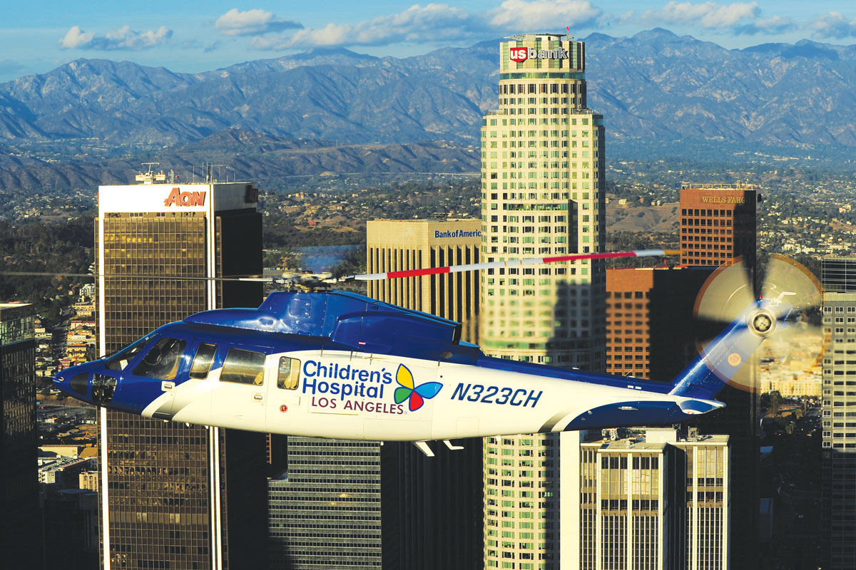 CHLA's new Sikorsky helicopter flying over downtown Los Angeles