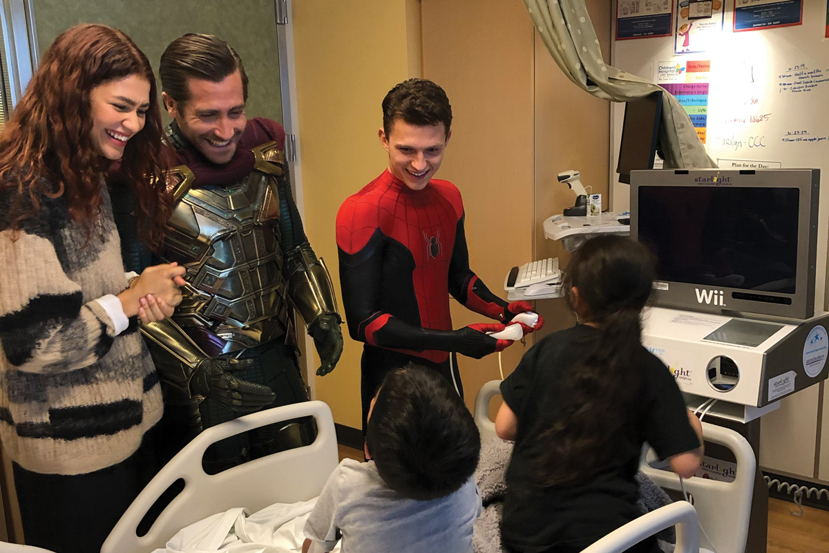 Zendaya, Jake Gyllenhaal and Tom Holland sharing a laugh with patients