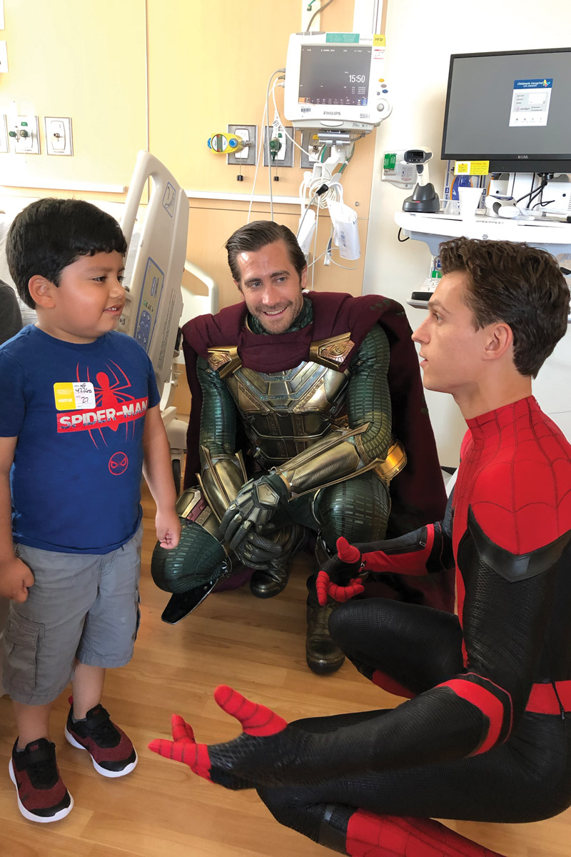 Edgar Barrerra, the brother of a CHLA patient, with Jake Gyllenhaal and Tom Holland