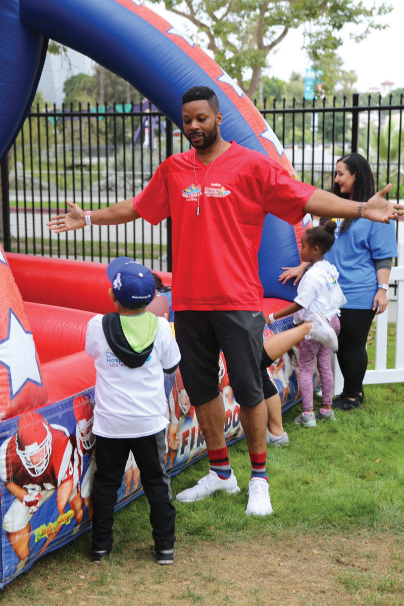 NFL veteran Kerry Rhodes led a sports clinic for kids.