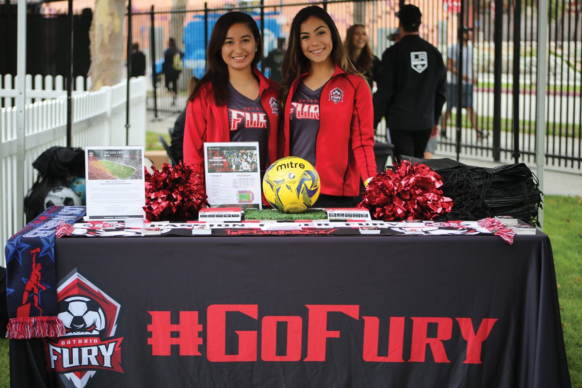 Representatives of the Ontario Fury indoor soccer team at the team's welcome table