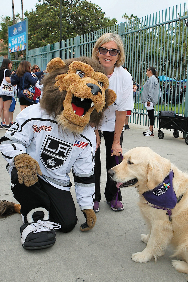 LA Kings mascot Bailey with CHLA Dog Therapy volunteer Shelley Buck and therapy dog Yogi