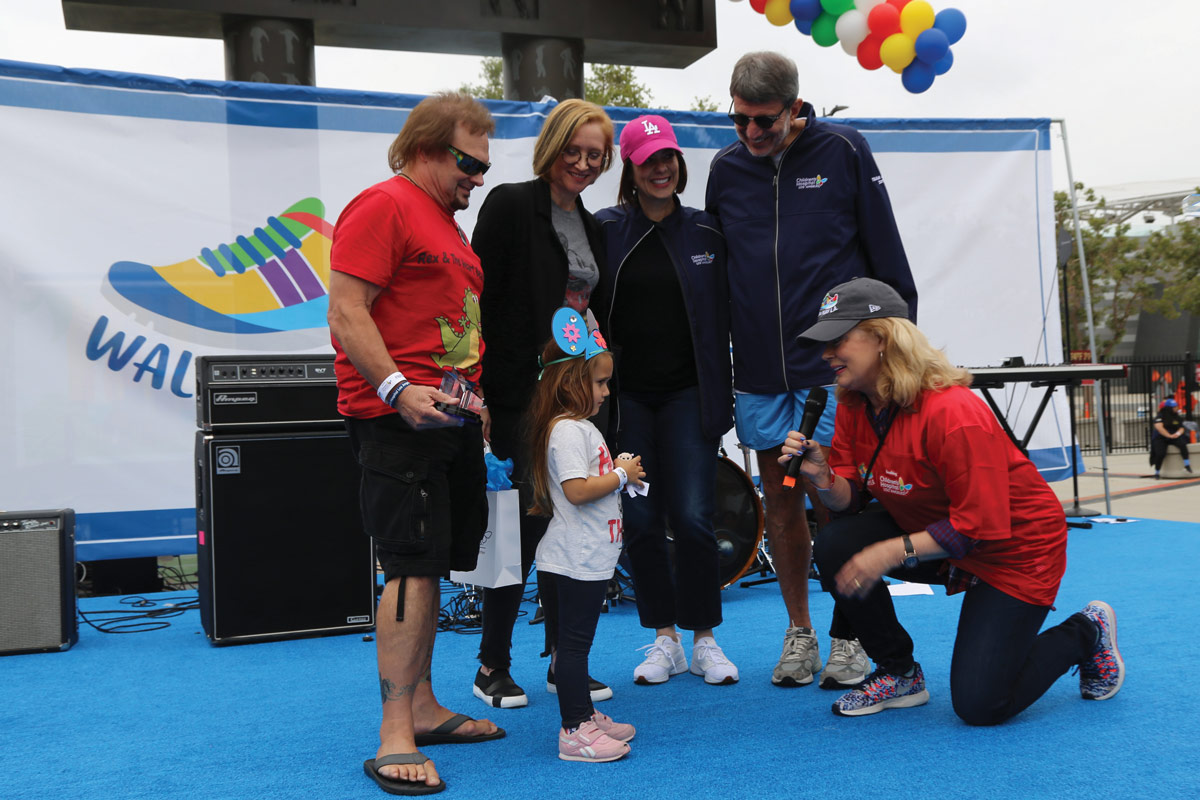 Left to right: One of the event's top fundraisers, Michael Anthony, former Van Halen bass player, and his granddaughter, Nina Becerra, onstage with Elissa Margolis, Disney Senior Vice President of Enterprise Social Responsibility; CHLA Senior Vice President and Chief Development Officer Alexandra Carter; CHLA President and CEO Paul S. Viviano; and CHLA Foundation Board of Trustees member Mary Hart