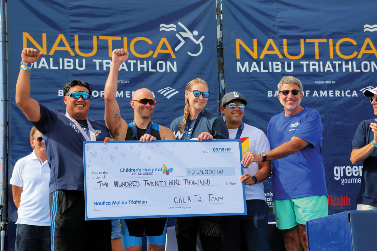 Team CHLA raised $229,000 for this year's race. Left to right: Team captains Marlon Duarte, Dave Abbott, Leslie Stach and Steven Viramontes with CHLA President and CEO Paul S. Viviano during the check presentation