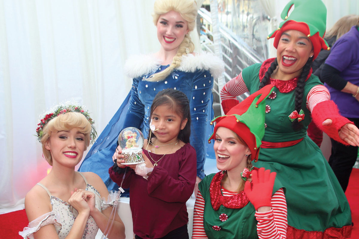 Winter wonderland characters with CHLA patient Kimberlyn