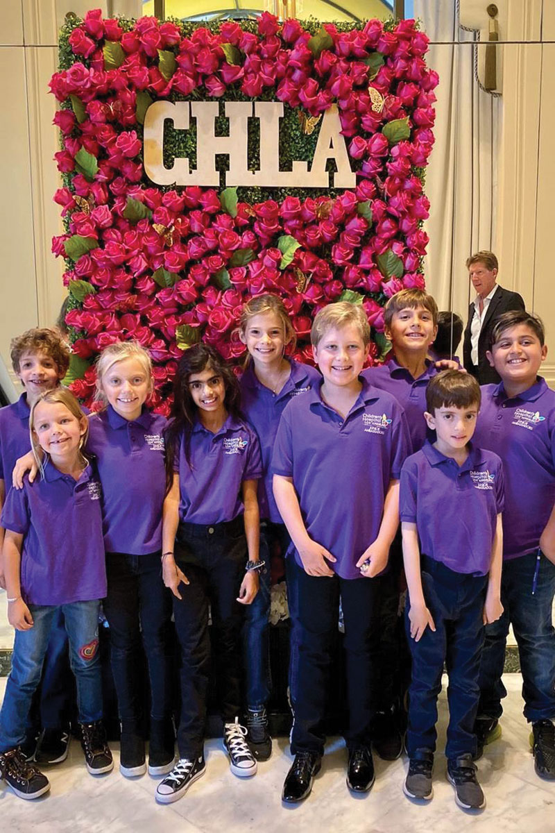 "The annual Westside Guild Luncheon of Hope was decorated with flowers to match the event's theme, ""Where Hope Grows, Miracles Blossom."" Left to right: CHLA Junior Ambassadors Dylan and Madison Schumer, Shira Josephson, Saira Rahemtulla, Caroline Fleiss, Blake Meidel, Benji Fleiss, Javen Rahemtulla and Oliver Eshagoff"