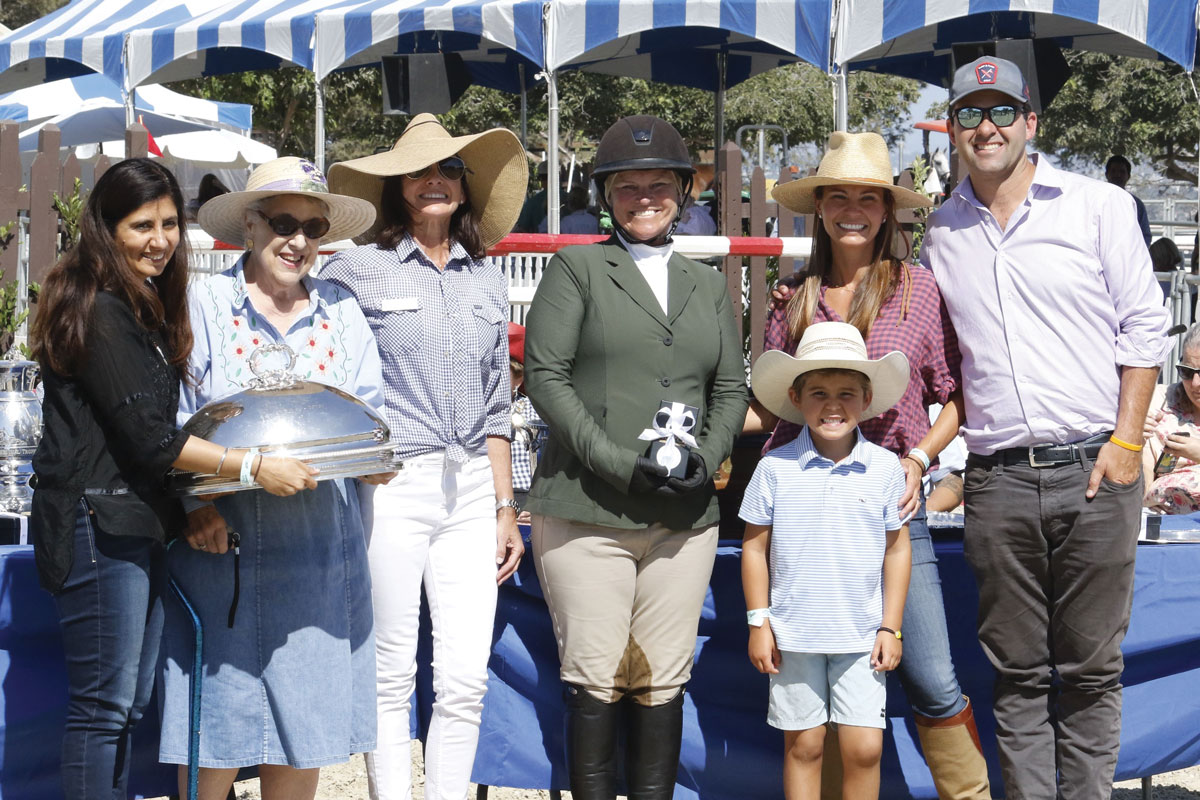 The Gabriel C. Duque, Jr. Memorial Trophy presentation at the Peninsula Committee's 2019 Portuguese Bend National Horse Show. Left to right: Deepa Bhojwani, MD; Bonnie McClure, a member of the CHLA Foundation Board of Trustees and Chair of the Associates and Affiliates; Lisa Gentry, 2019 Peninsula Committee President; winning rider Nicole Lean; and Blake, Andrika and Bill King