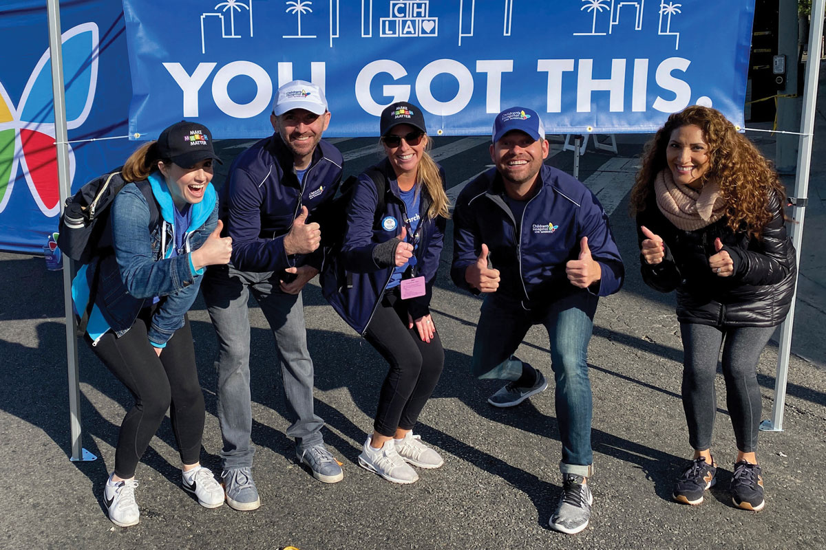 Members of the CHLA Foundation encourage runners in the CHLA Cheer Zone. Left to right: Emma Standring-Trueblood, Michael Sandler, Jillian Green, Matt Semler and Veronica Soltero