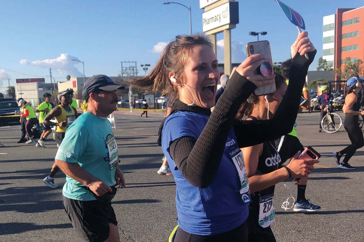 Team CHLA runner Annie Cornforth snaps a selfie as she nears the CHLA Sunset campus.