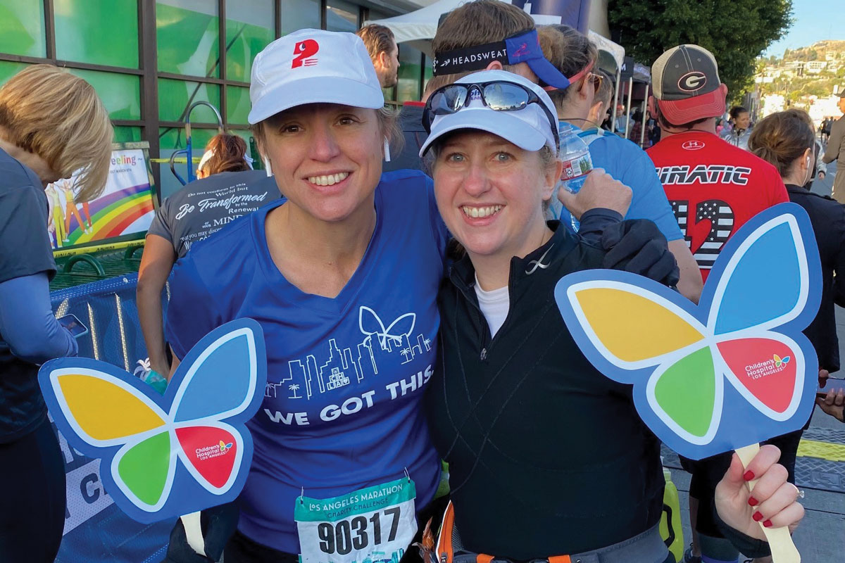Half-marathon runners Julie Halverson and Erin Cockrill demonstrate their CHLA pride before the race begins.