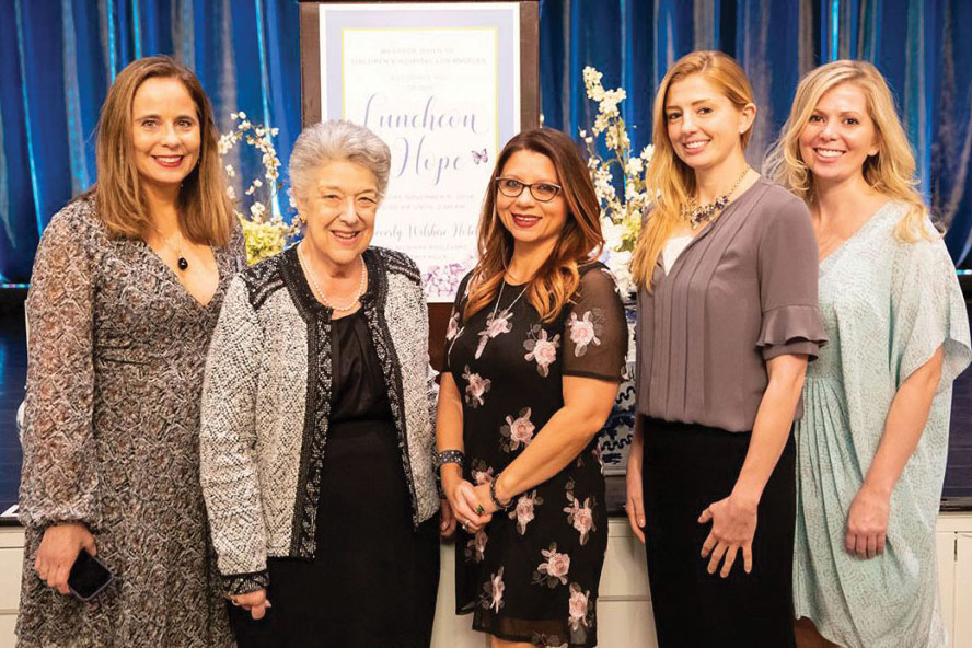 Left to right: Lee Ann Sanderson, 2018 President of the Westside Guild; Bonnie McClure, Chair of the Associates and Affiliates at CHLA; patient mom Bobbie Gerson; and CHLA physicians Lindsay Andras, MD, and Lydia Andras, MD, at the Westside Guild's Luncheon for Hope fundraiser at the Beverly Wilshire Hotel on Nov. 6, 2018