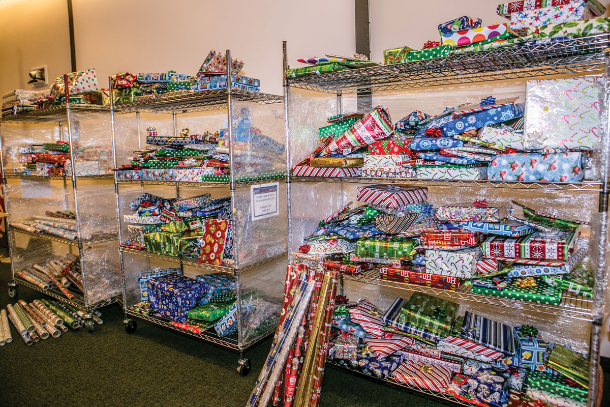 Shelves of gifts at the Holiday Family Volunteer Day