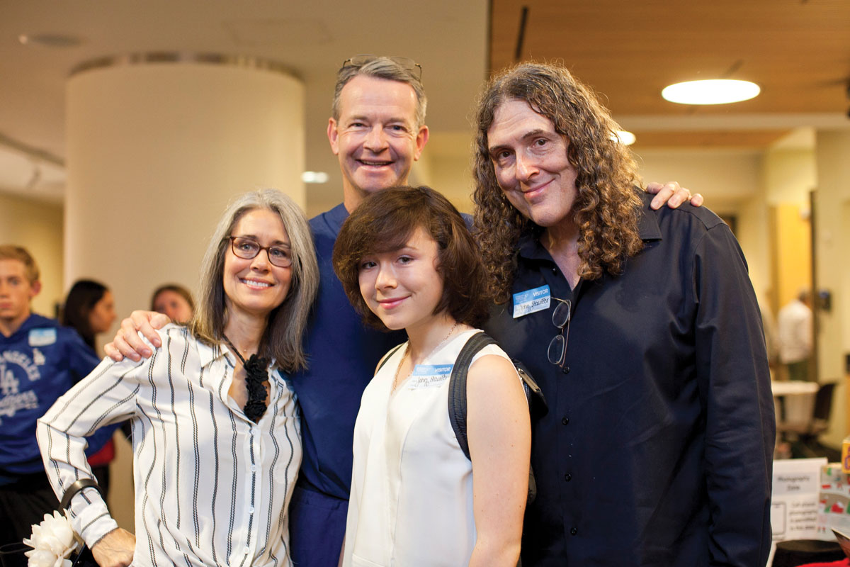 David L. Skaggs, MD, MMM, with (from left) Suzanne, Nina and Al Yankovic at the Holiday Family Volunteer Day