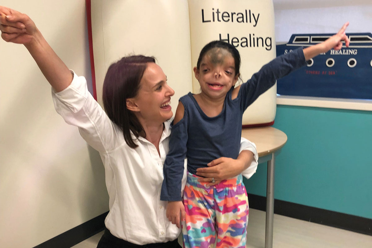Actress Natalie Portman with CHLA patient Teresa Alaniz, after reading to kids as part of CHLA's Literally Healing Program