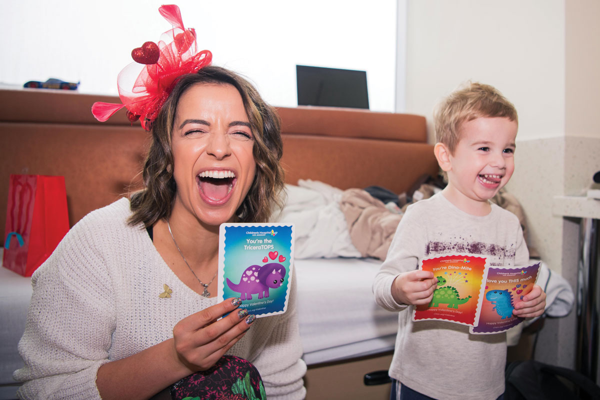 ESPN personality and Paralympian swimmer Victoria Arlen, seen here with patient Tucker Hayden, handed out valentines at CHLA.