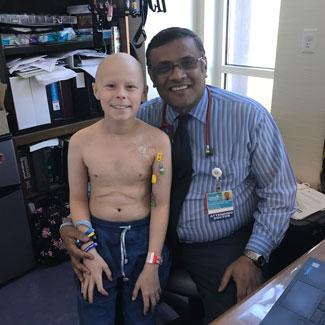 Malakai with Dr. Leo Mascarenhas