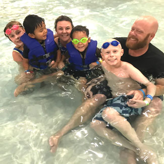 Malakai swimming with his family
