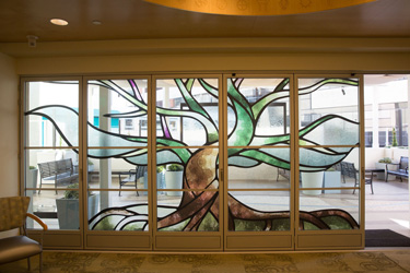 Stained glass wall with tree design